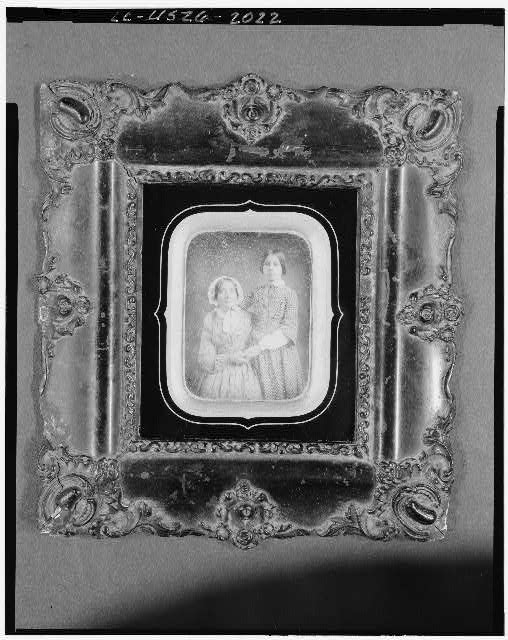 [Two unidentified women, three-quarter length portrait, facing front]