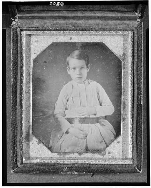 [Unidentified boy, three-quarter length portrait, seated]