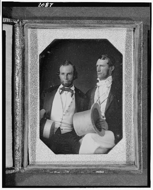 [Henry and William Pinkney Rodgers, three-quarter length portrait, seated, holding hats]