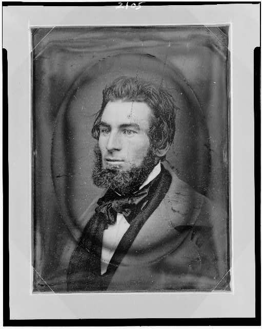 [Unidentified man, head-and-shoulders portrait, facing left]