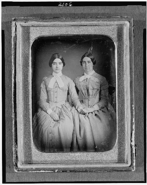 [Two unidentified women, three-quarter length portraits, seated]