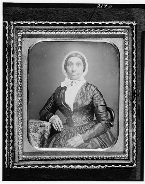 [Jerusha Field, half-length portrait, seated in chair, with arm resting on table with tablecloth]