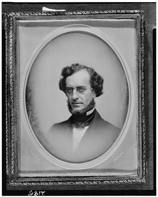 [James Curtis Booth, head-and-shoulders portrait, facing left]