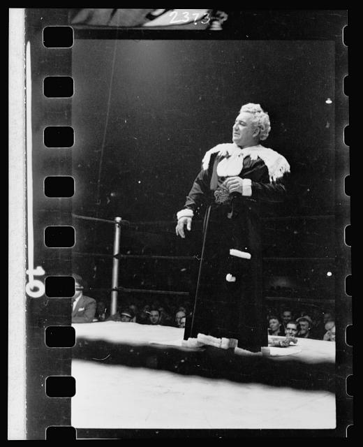 [Gorgeous George, full-length portrait, standing in wrestling ring, facing left]