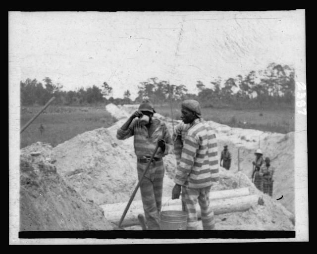 [African American convicts working at an outdoor location]