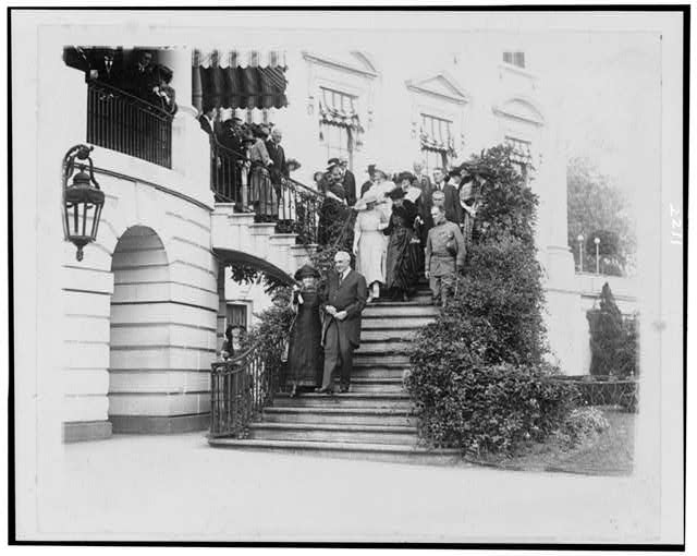 [Pres. Warren G. Harding escorting Madame Curie down steps to south grounds of the White House]
