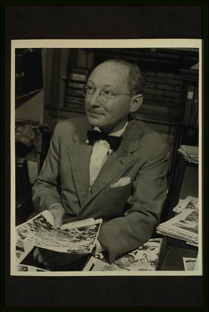 [Dr. Otto Bettmann, half-length portrait, seated, facing slightly left, holding pictures]