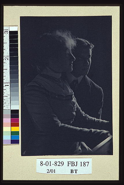[Woman and a man, facing right, half-length portrait]