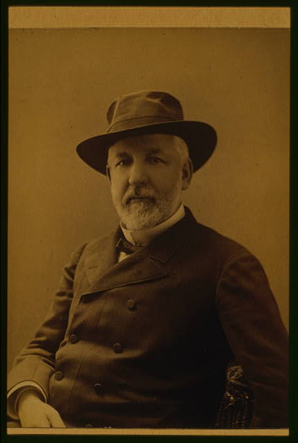 [James G. Blaine, 1884 Republican presidential candidate, half-length portrait, seated, wearing hat and coat, facing front]