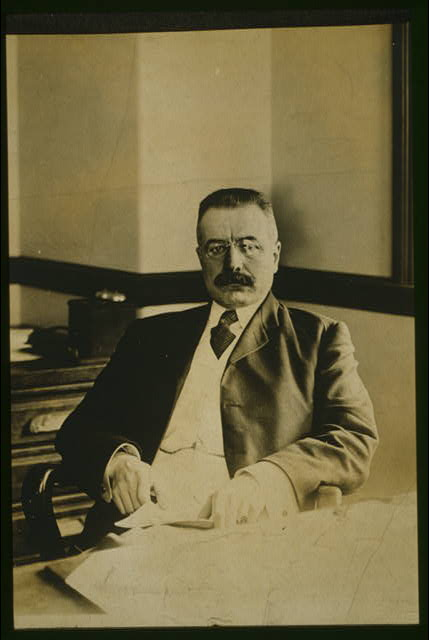 [George B. Cortelyou, half-length portrait, seated at desk, facing front]