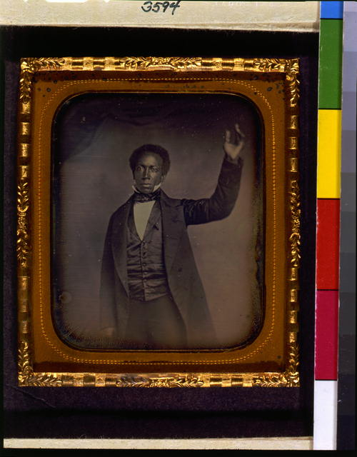 [Edward J. Roye, three-quarter length portrait, standing, with hand raised]