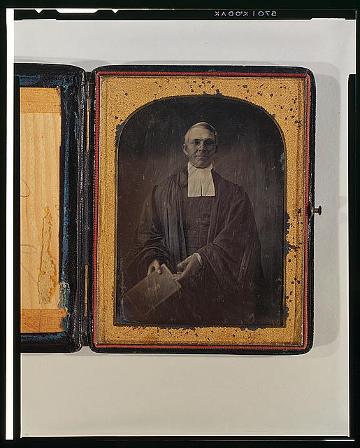 [Occupational portrait of an unidentified clergyman, three-quarter length, facing front, holding Bible]