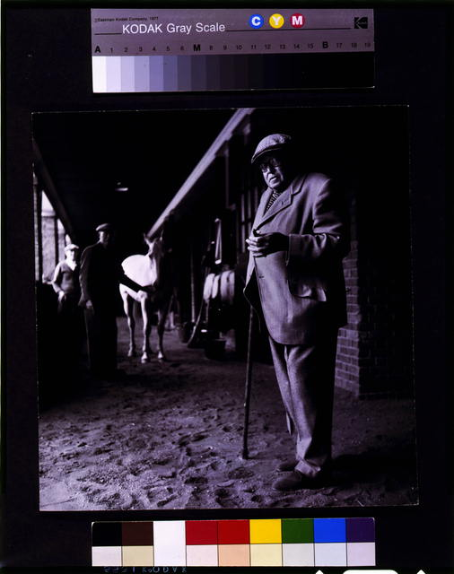 [Horse breeder Ambrose Clark, full-length portrait, standing in barn, facing front]