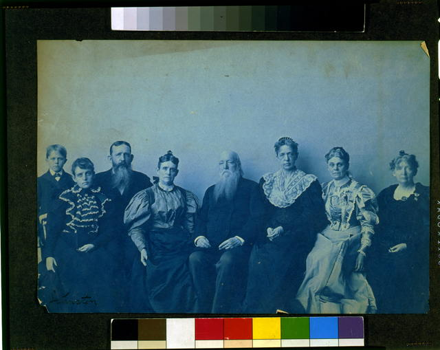 [Frances Benjamin Johnston posed with seven members of her family, in her Washington, D.C. studio(?)]