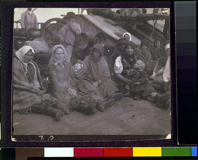 [Group of emigrants (women and children) from eastern Europe on deck of the S.S. Amsterdam]