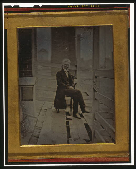 [John McAllister, Jr., full-length portrait, seated in a chair, outdoors on the roof of 48 Chestnut Street, Philadelphia]