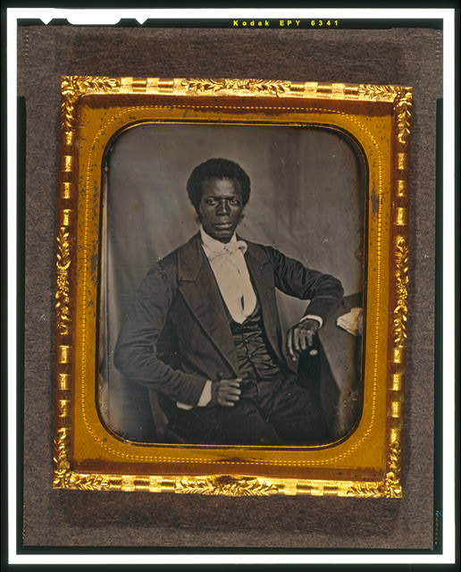 [James M. Priest, three-quarter length portrait, full face, seated at desk]
