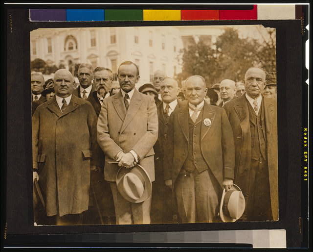 [President Coolidge with an international delegation from the Scottish Rite of Freemasonry, including John Henry Cowles, the Sovereign Grand Commander, to the President's right]