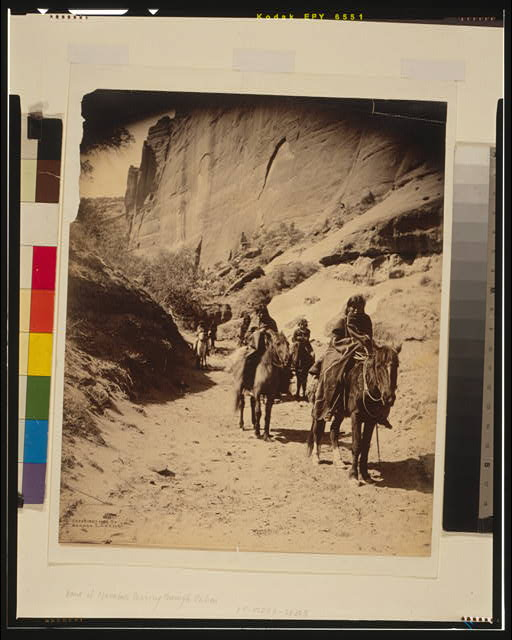 Band of mounted Navahos passing through Cañon