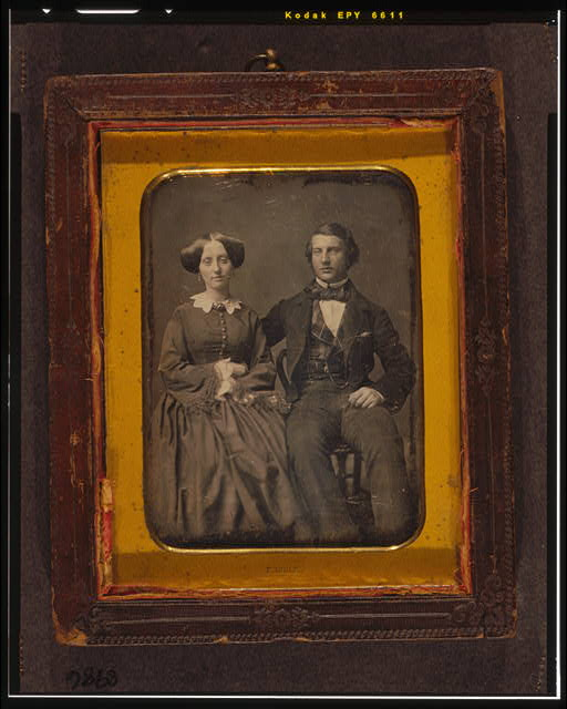 [Unidentified man and woman, full-length portrait, seated]