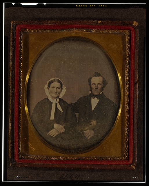 [Unidentified man and woman, half-length portrait, seated]