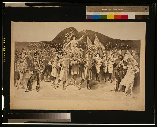 [Woman draped in flag carried by women in Roman costume, surrounded by crowds]