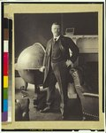 Theodore Roosevelt, full-length portrait, standing beside large globe, facing front