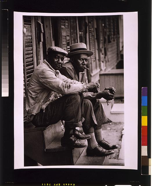 [Two African American men sitting on stoop, Charleston, South Carolina]