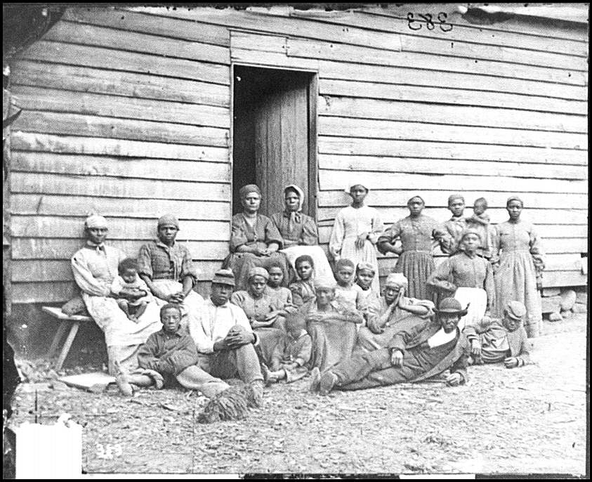 "[Cumberland Landing, Va. Group of ""contrabands"" at Foller's house]"