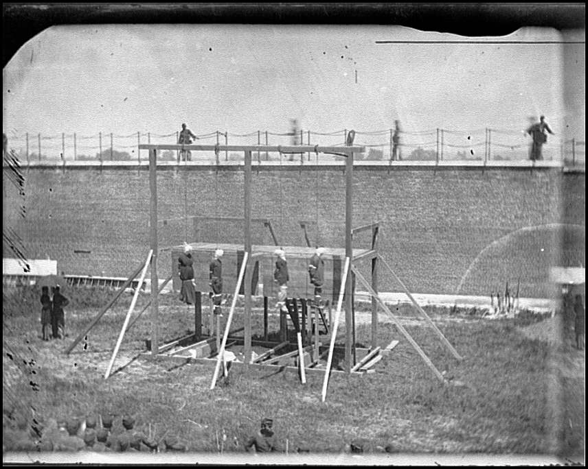 [Washington, D.C. Hanging bodies of the conspirators; guards only in yard]