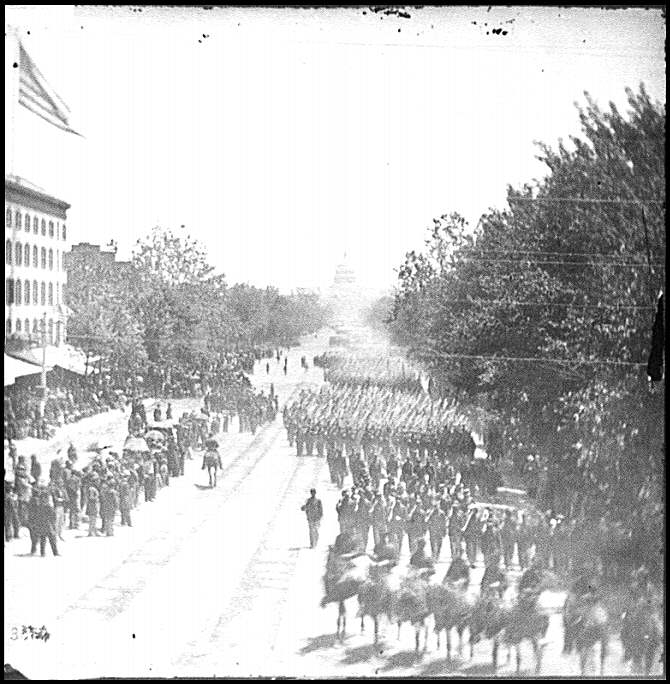 [Washington, D.C. Infantry units with fixed bayonets passing on Pennsylvania Avenue near the Treasury]