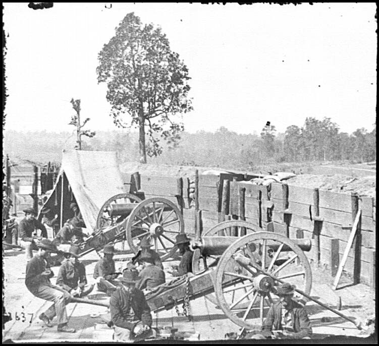 [Atlanta, Ga. Federal soldiers relaxing by guns of captured fort]