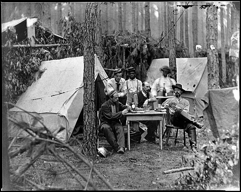 [Petersburg, Va. Officers of the 114th Pennsylvania Infantry playing cards in front of tents]