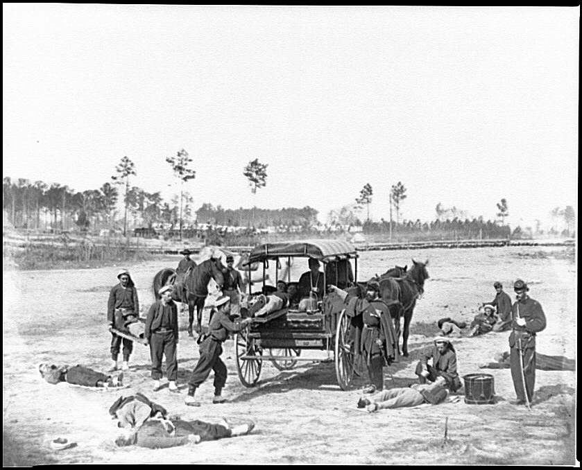 [Unknown location. Zouave ambulance crew demonstrating removal of wounded soldiers from the field]