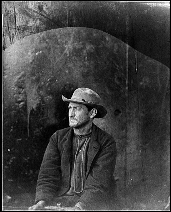 "[Washington Navy Yard, D.C. Edman Spangler, a ""conspirator,"" in hat and manacled]"