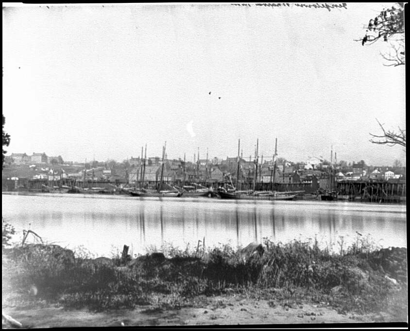 [Washington, D.C. Georgetown waterfront with sailing vessels, seen from Mason's Island]