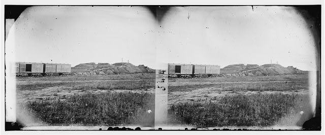 Manassas, Virginia. Confederate fortifications. (U.S. Military Railroad boxcars on left.) Orange & Alexandria Railroad