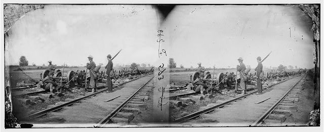[Manassas Junction, Va. Soldiers beside damaged rolling stock of the Orange & Alexandria Railroad]