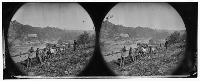 [Jericho Mills, Va. Party of the 50th New York Engineers building a road on the south bank of the North Anna, with a general headquarters wagon train crossing the pontoon bridge]