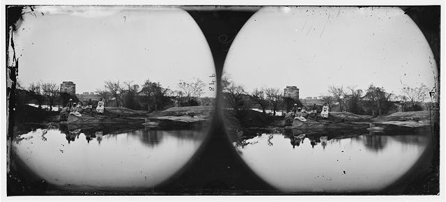 Richmond, Virginia. Ruins of Richmond & Petersburg railroad bridge from island in James River