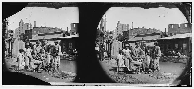 "Richmond, Virginia. Group of Negroes (""Freedmen"") by canal"