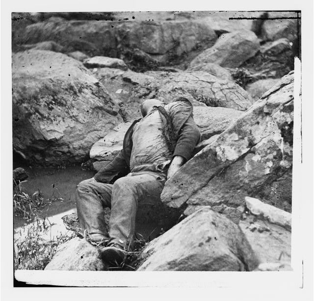 Gettysburg, Pennsylvania. Dead Confederate sharpshooter at the foot of Round Top