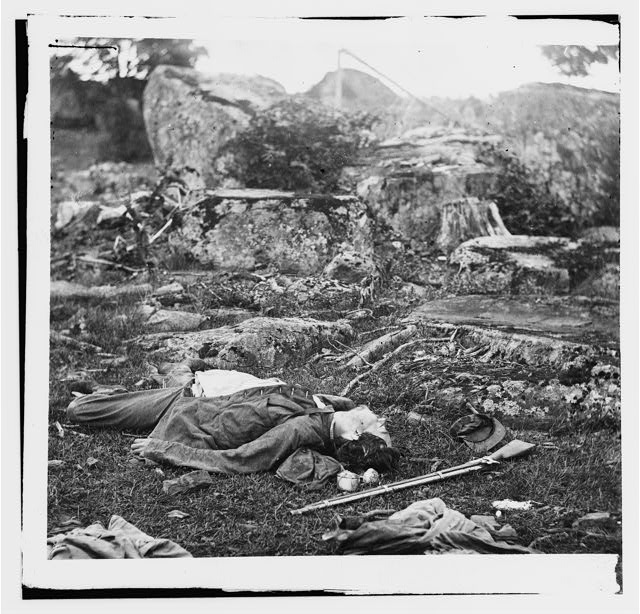 "[Gettysburg, Pa. Dead Confederate soldiers in ""the devil's den""]"