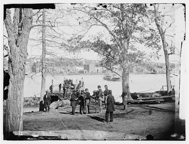 [Washington, D.C. Guards at ferry landing on Mason's Island examining a pass]