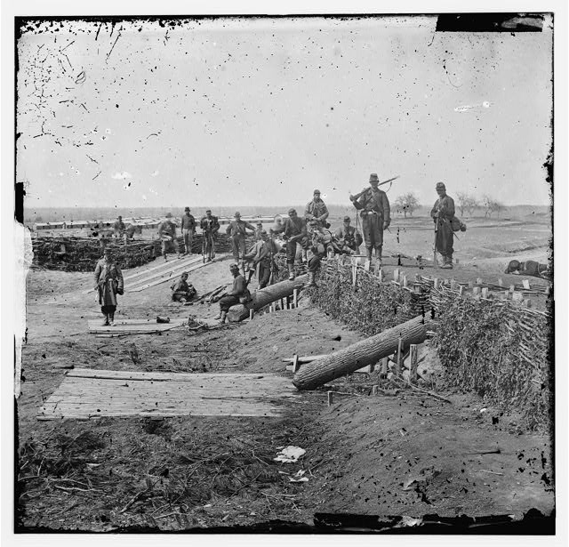 [Group of Federal soldiers in Confederate fort on heights of Centreville with Quaker guns]