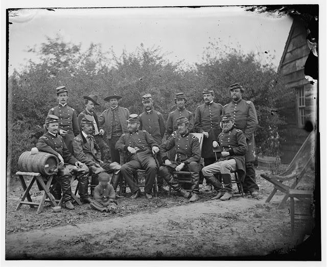 Cumberland Landing, Virginia. Seated: Generals, Andrew A. Humphreys, Henry Slocum, Wm B. Franklin, Wm F. Barry and John Newton. Officers standing not indentified