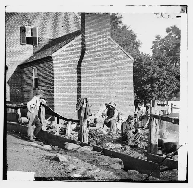 Culpeper Court House, Virginia. Scene in the town with Federal soldiers and wounded Negro