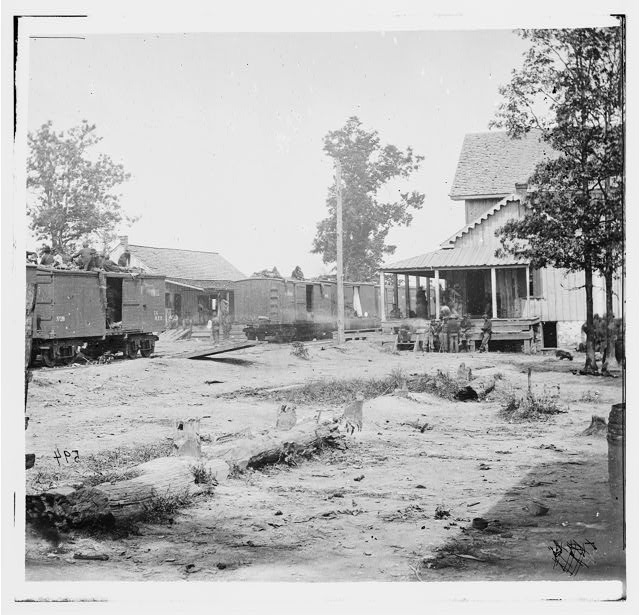 [Catlett's Station, Va. The station with U.S. military railroad boxcars and soldiers]