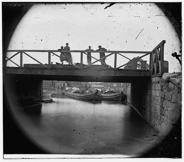 [Richmond, Va. Bridge over the Canal; barges beyond]