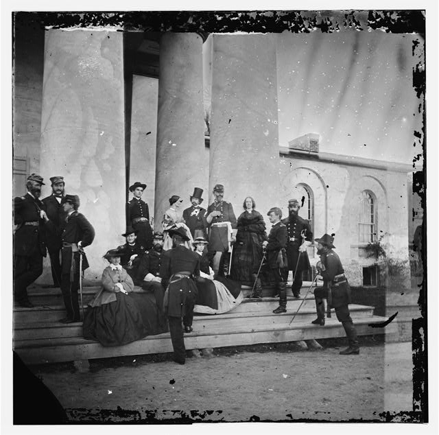 Arlington, Virginia (vicinity). Gen. Samuel P. Heintzelman and staff at Arlington house. (Mathew B. Brady, the photographer is shown in a top hat)